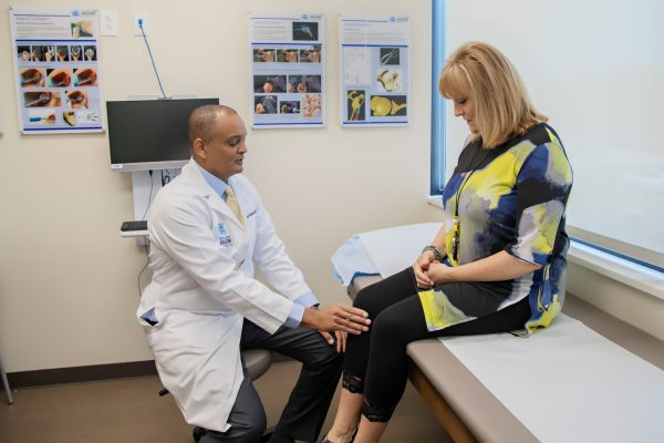 Dr. Gobezie helps a patient with knee pain